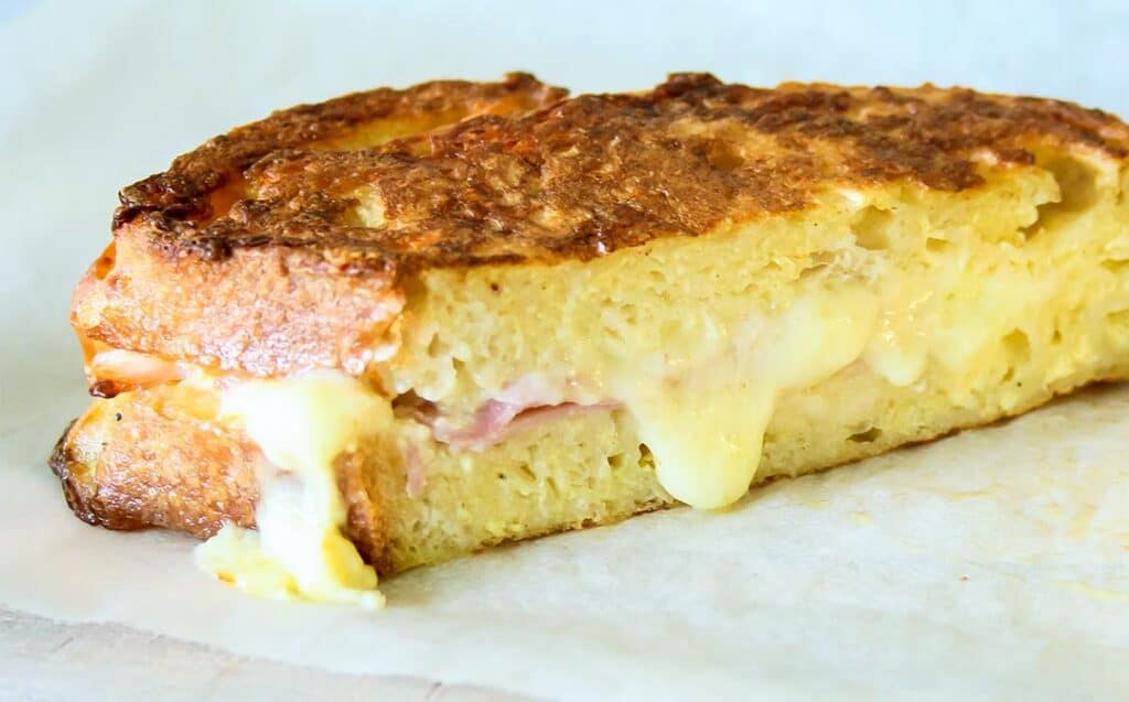 half of a french toast ham and cheese sandwich