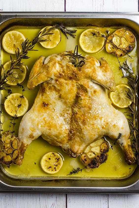 a flattened roast chicken with lemon and herbs