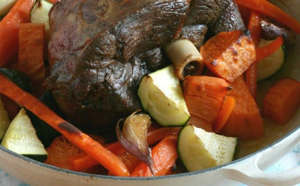 A casserole dish with roast meat and vegetables