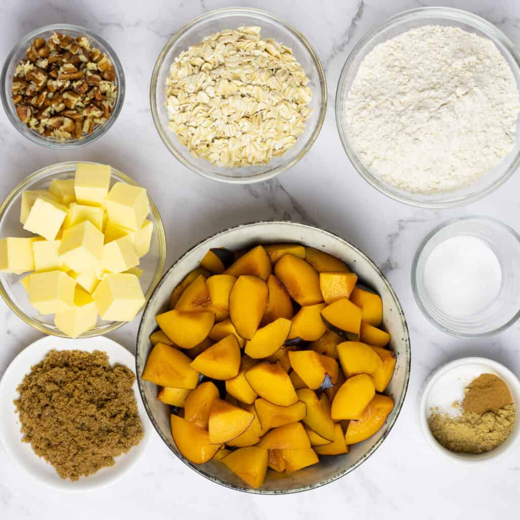 ingredients in individual bowl on a marble counter top