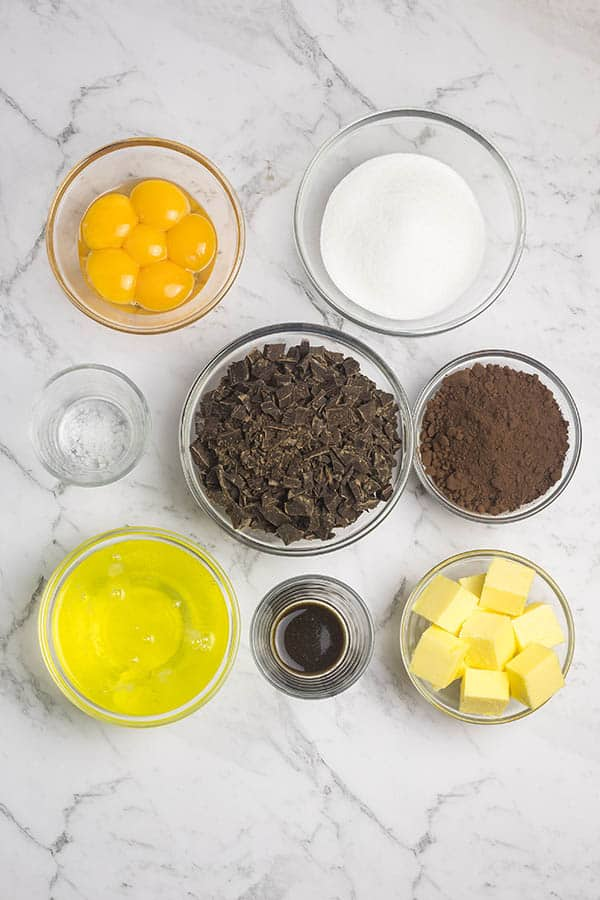 Ingredients in individual bowls for flourless chocolate cake