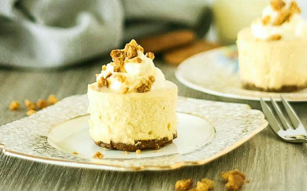 an individual malted vanilla cheesecake on a gold rimmed plate