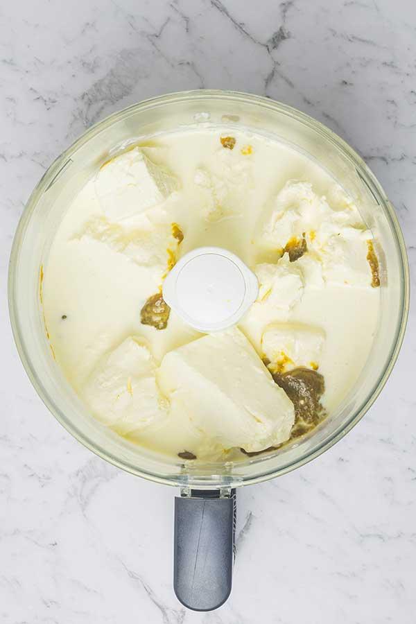 cream cheese, cream and pumpkin puree in a food processor