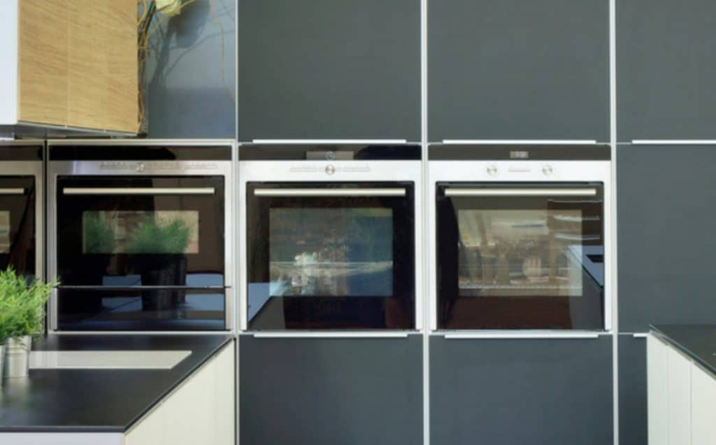 wall of kitchen cabinets with inbuilt ovens