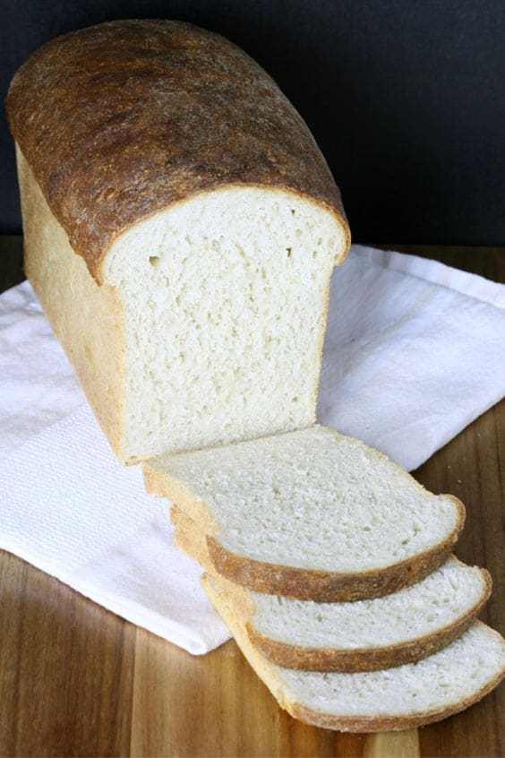 sliced loaf of honey oat sandwich bread, baked in a steam oven