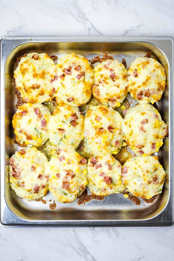 overhead view of a square pan full of cheesy twice baked potatoes