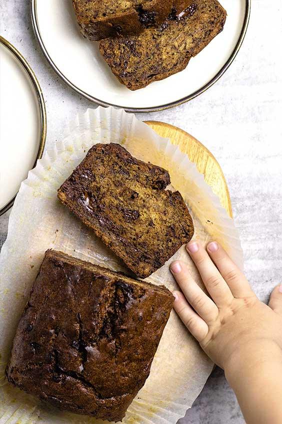 choc chunk banana bread with cheeky hand