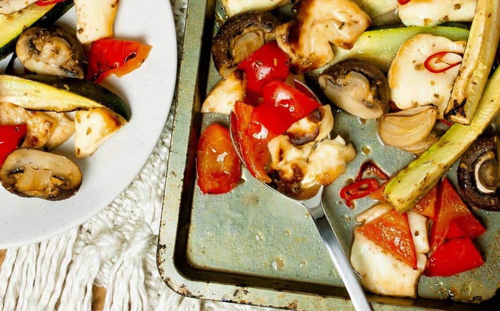 Mediterranean vegetables and halloumi baked on an oven tray