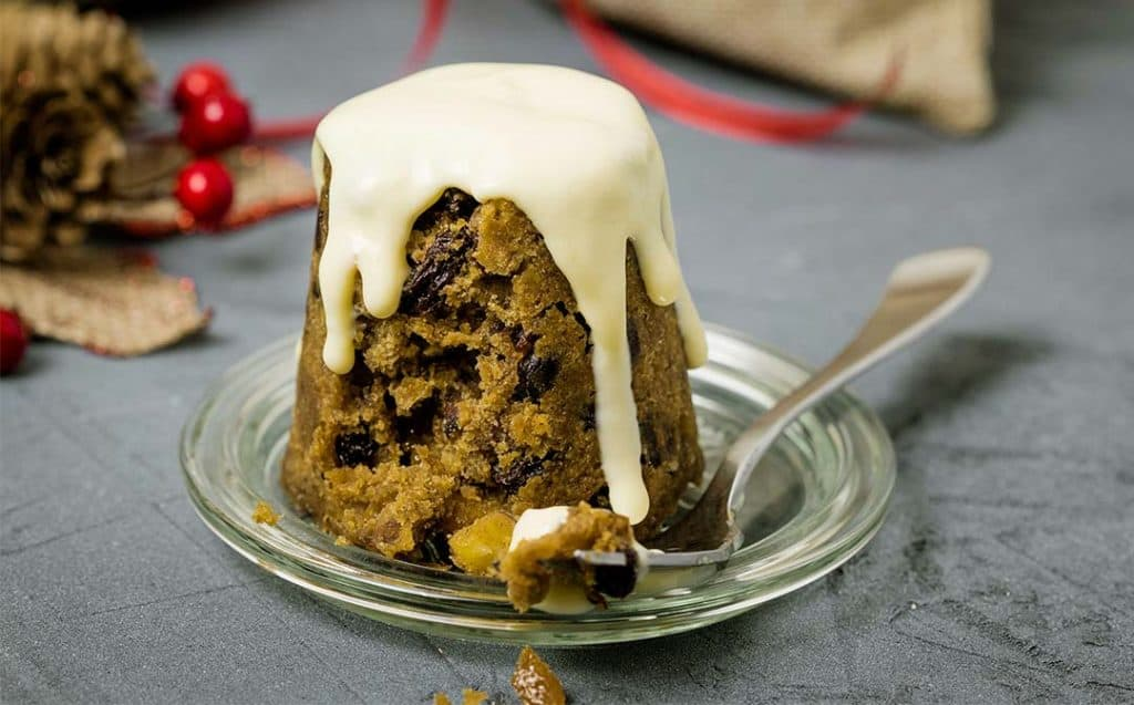 individual christmas pudding with custard
