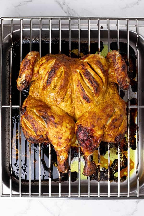 flattened tandoori roasted chicken on rack