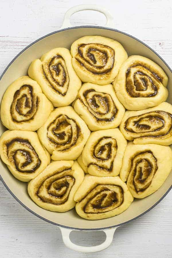 cinnamon rolls in a cast iron baking dish