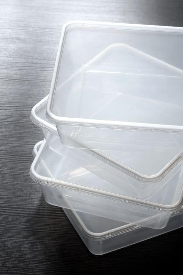 empty plastic takeout containers in a stack