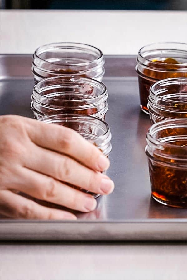 cooked caramel in small glass jars