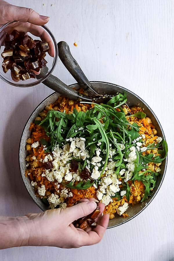 Couscous and chickpea salad with a bowl of dates