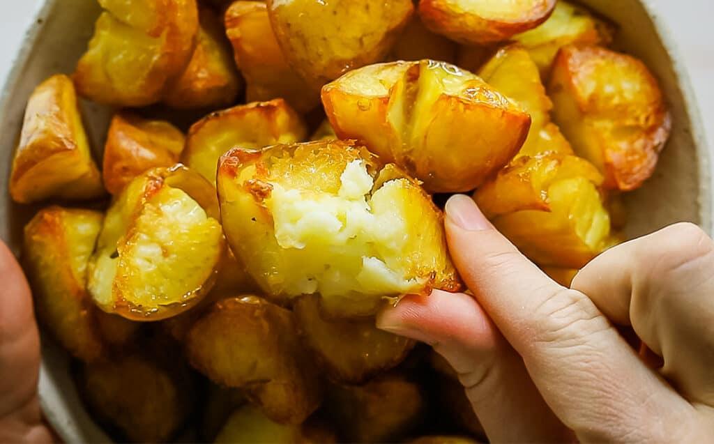 close up golden roasted potatoes